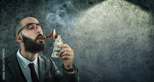 Fototapeta money burning - businessman arrogant obraz