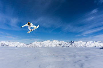 Fototapeta Sport Flying snowboarder on mountains