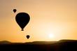 Silhouette of hot air balloons fly over Cappadocia.