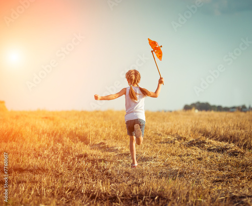 cute little girl with a  windmill Tablou Canvas