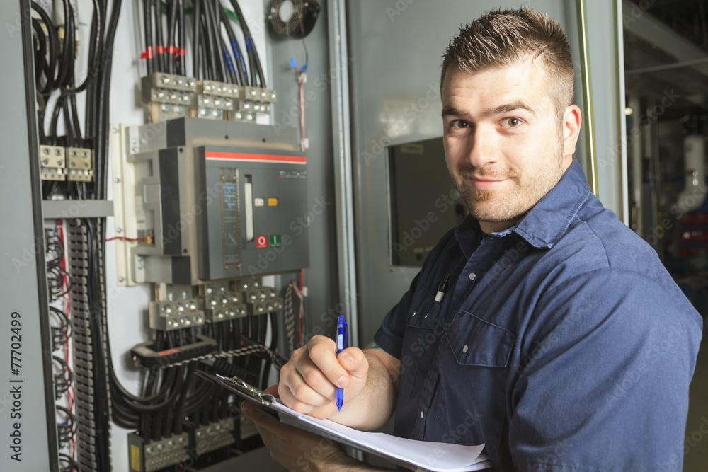 Fototapeta Portrait of an happy worker in a factory