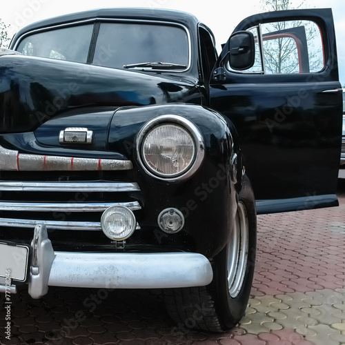 Old retro or vintage car front side © xmagics