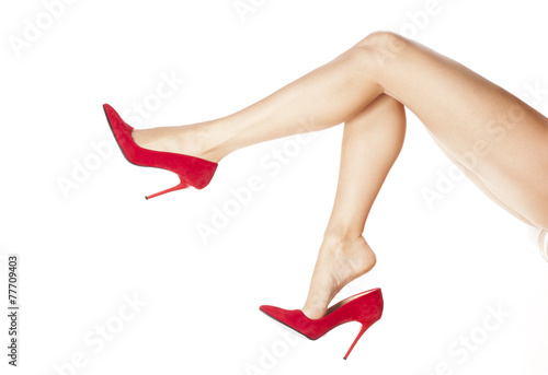 Fotografia  pretty female legs in red high heels