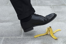 Businessman About To Step On A...