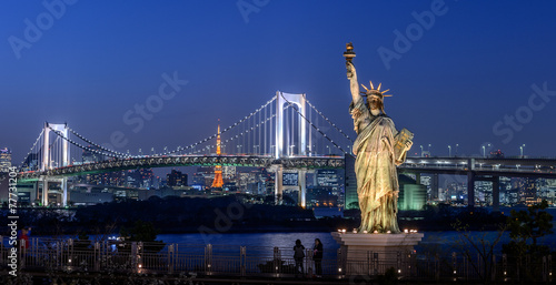 Rainbow bridge at Odaiba with Tokyo skyline at night