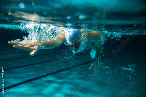 Male swimmer at the swimming pool.Underwater photo. Canvas Print