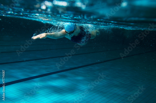 Female swimmer at the swimming pool.Underwater photo. Canvas Print