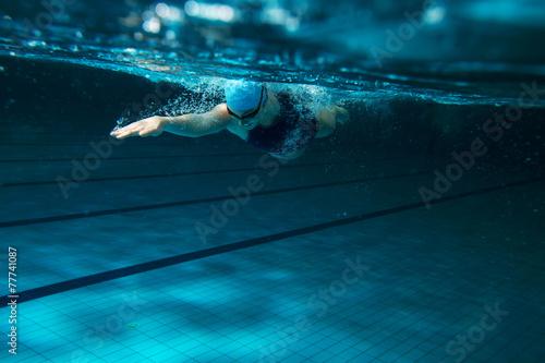 Fototapeta Female swimmer at the swimming pool.Underwater photo. obraz