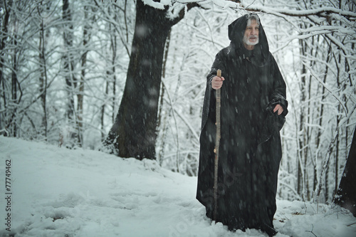 Old pilgrim in iced forest Canvas Print