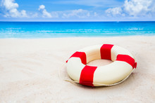 Vintage Life Buoy On The Sand At The Beach