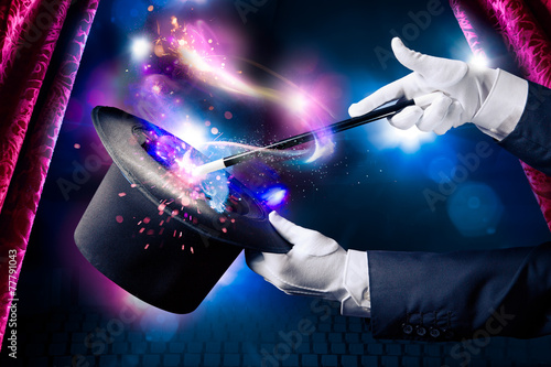 Fotografía High contrast image of magician hand with magic wand