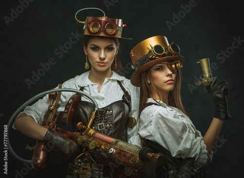Photo  Two girls dressed in the style of steampunk with arms