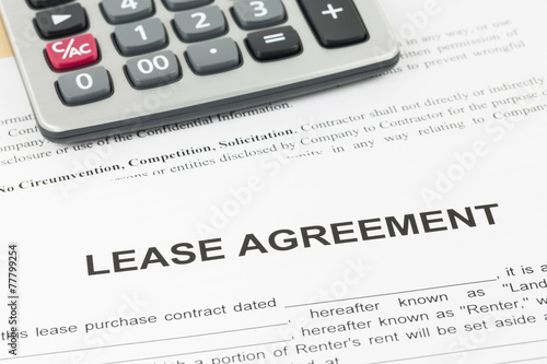 Lease Agreement Document With Calculator Buy This Stock Photo And