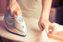 Close-up Of Maid Ironing Cloth...