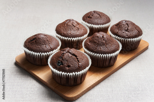 Fotografie, Obraz  Chocolate muffins on the cutting board
