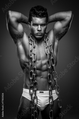 Valokuva  Brutal guy with steel chain