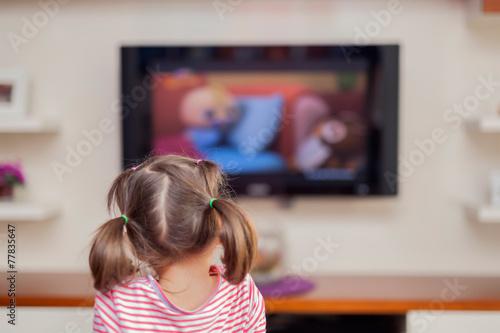 little cute girl watching tv