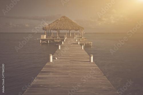 In de dag Ochtendgloren Vintage Beach Deck with Palapa floating in the water