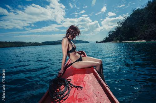 Fototapeta Sexy young woman on boat in the tropics obraz na płótnie