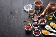 Various Condiments On Table With Copy Space