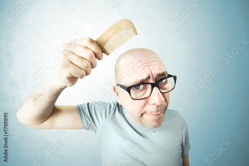 nostalgic man comb his bald head in the morning Wallpaper Mural