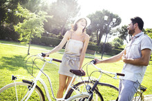 Couple Having Fun By Bike On H...