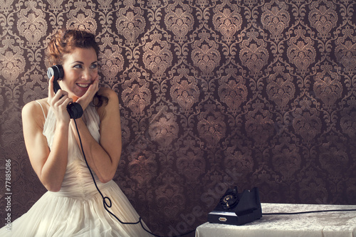 Fotografie, Obraz  Beautiful young woman on the phone in living room