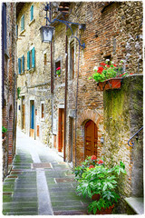 Fototapeta Uliczki charming old streets of medieval towns of Italy