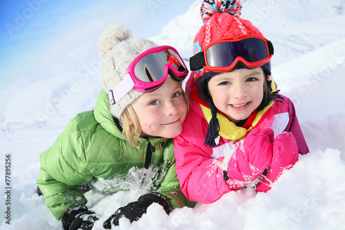 Papiers peints Glisse hiver Portrait of kids enjoying winter vacation at ski resort
