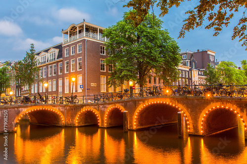 Photo  Night illumination of Amsterdam canal and bridge