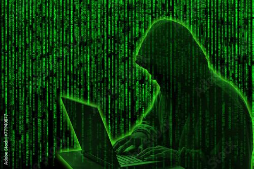 Fotografía  Conceptual image of a hacker on green matrix background