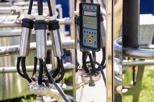 Fotografie, Obraz  Automatic mechanized milking equipment for farm industry