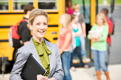 Photo School Bus: Cheerful Teacher By School Bus