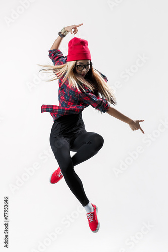 Fényképezés  young beautiful dancer jumping on a studio background