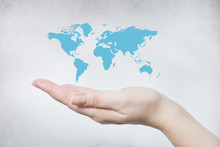Hand Holding The World Map