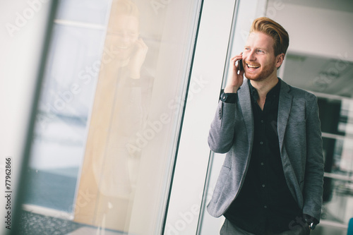Fototapety, obrazy: Young man with mobile phone