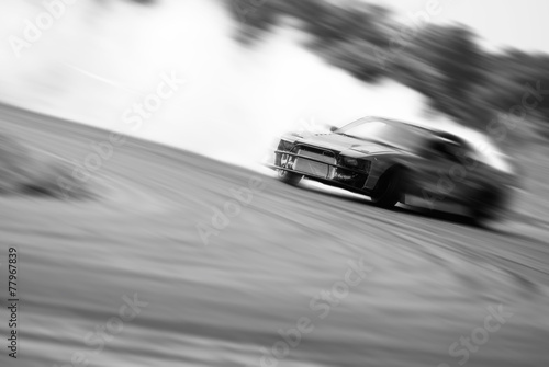 Very fast driving, motion blur drift black and white Poster Mural XXL