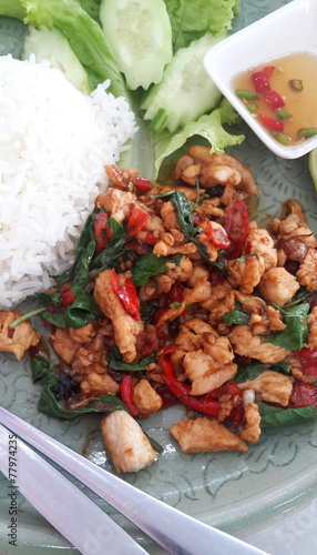 Thai spicy food, stir fried chicken with basil on rice.