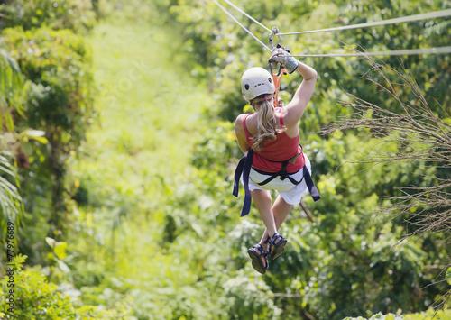 Obraz Woman going on a jungle zipline adventure - fototapety do salonu