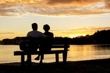Couple Watching A Beautiful Su...