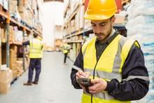 Focused Worker Wearing Yellow ...
