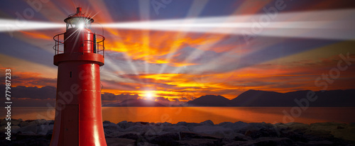Poster Phare Red Lighthouse with Light Beam at Sunset