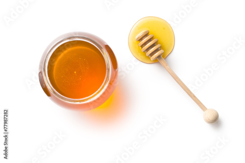 Fotografering honey dipper and honey in jar