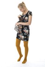 Young Woman Wearing A Short Tight Mini Dress Looking In Handbag