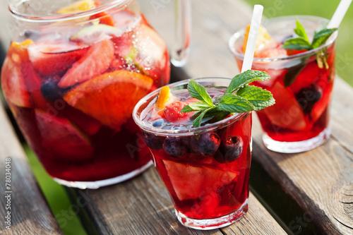 Fototapeta Refreshing sangria (punch) with fruits, picnic idea