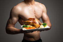 Young Man Holding Roast Chicken,healthy Lifestyle Concept