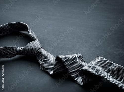 Fotografia  Grey tie on dark background