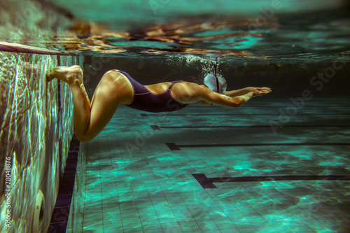 Swimmer at the swimming pool.Underwater photo. Canvas Print