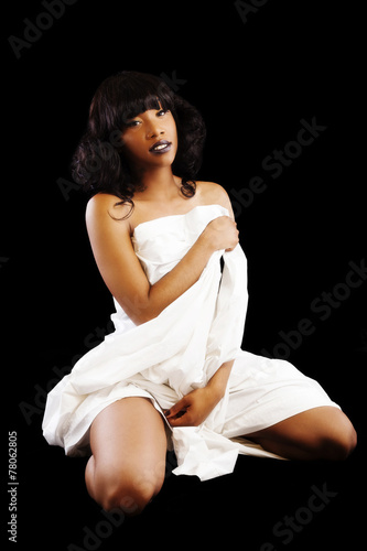 attractive african american woman kneeling white sheet buy this