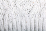 texture of white wool knit sweater homemade
